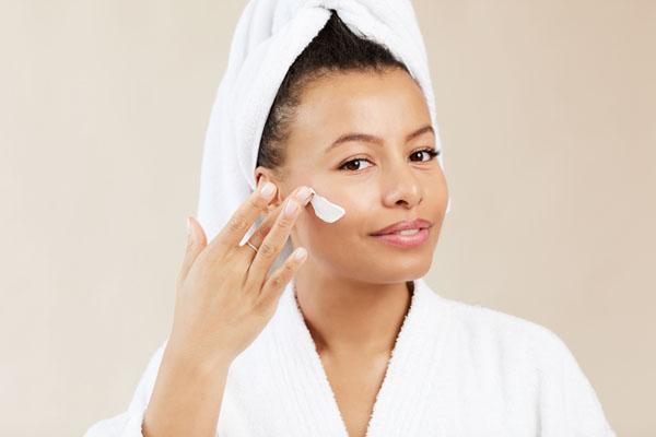 Beautiful Woman Applying Face Cream